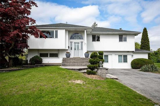 Great High Ranch In Desirable Commack School District. Beautiful open kitchen, bath with skylight. Master bedroom suite with private deck overlooking the expansive backyard and pool. Move in ready. This Home is An Entertainers Delight. Possible Mother And Daughter With Proper Permits.