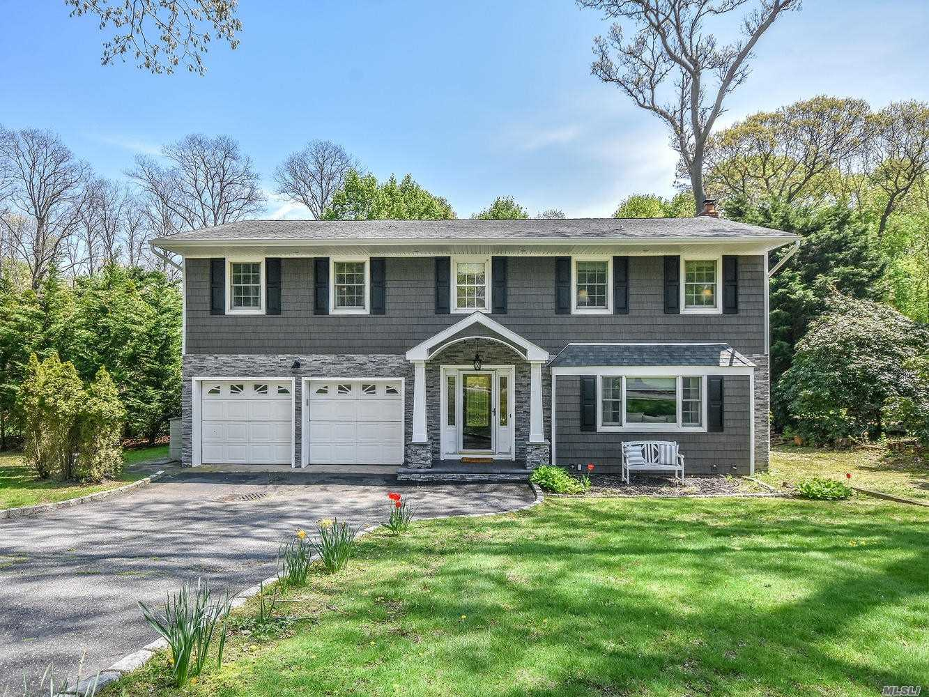 Stunning Brookfield Colonial on a quiet, tree-lined street in desirable Charter Oaks. Mid-block location backs to private woods. New Stone fireplace with remote start, new boiler, new siding/gutters, remodeled granite kitchen w/SS appliances and radiant heat, refinished oak floors, updated Anderson and Pella windows and beautiful sun-room. So gorgeous. Won't last!
