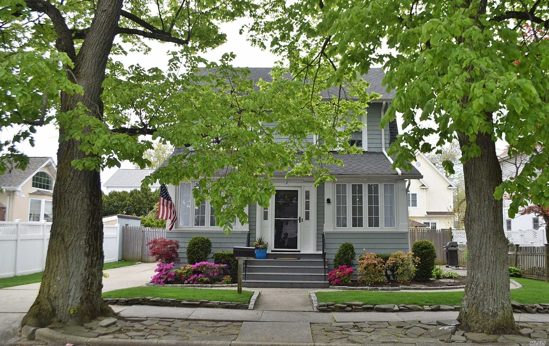 Just move in! Lynbrook SD. Welcoming, enclosed porch w/cathedral ceilings, LR, DR, Lg EIK with a ton of cabinets! Hardwood Floors. 2nd Fl boasts 3 Brs + bath w/entry to walk-up attic. Fin basement w/laundry rm, rec area + office/playroom. OSE to beautiful, fenced-in backyard w/2-car garage. H2O heater + gas boiler replaced late 2018. Approx 12yr roof. Newer windows + 150 amp electric. Walking distance to schools, <10min walk to LIRR, deli, gas, grocery, Movie Theater, Southern State + Belt Pkwy.