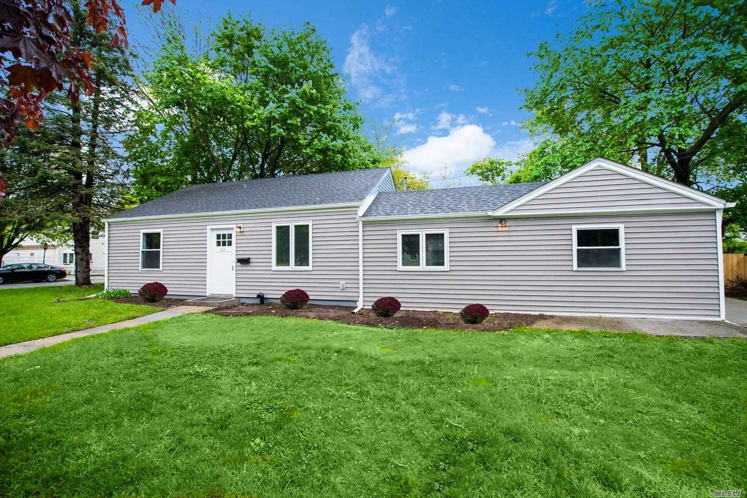 Come make your memories in this recently renovated 3br, 2ba recently renovated ranch. Home features cathedral ceiling, new white shaker kitchen, quartz counters, SS appliances. Hand scraped floors, updtaed electric, new boiler, Master w/ ba and WIC. Conveniently located to Hoftsra, Nassau colliseum and major freeways. Perfect starter home. An absolute must see. This one won't last!