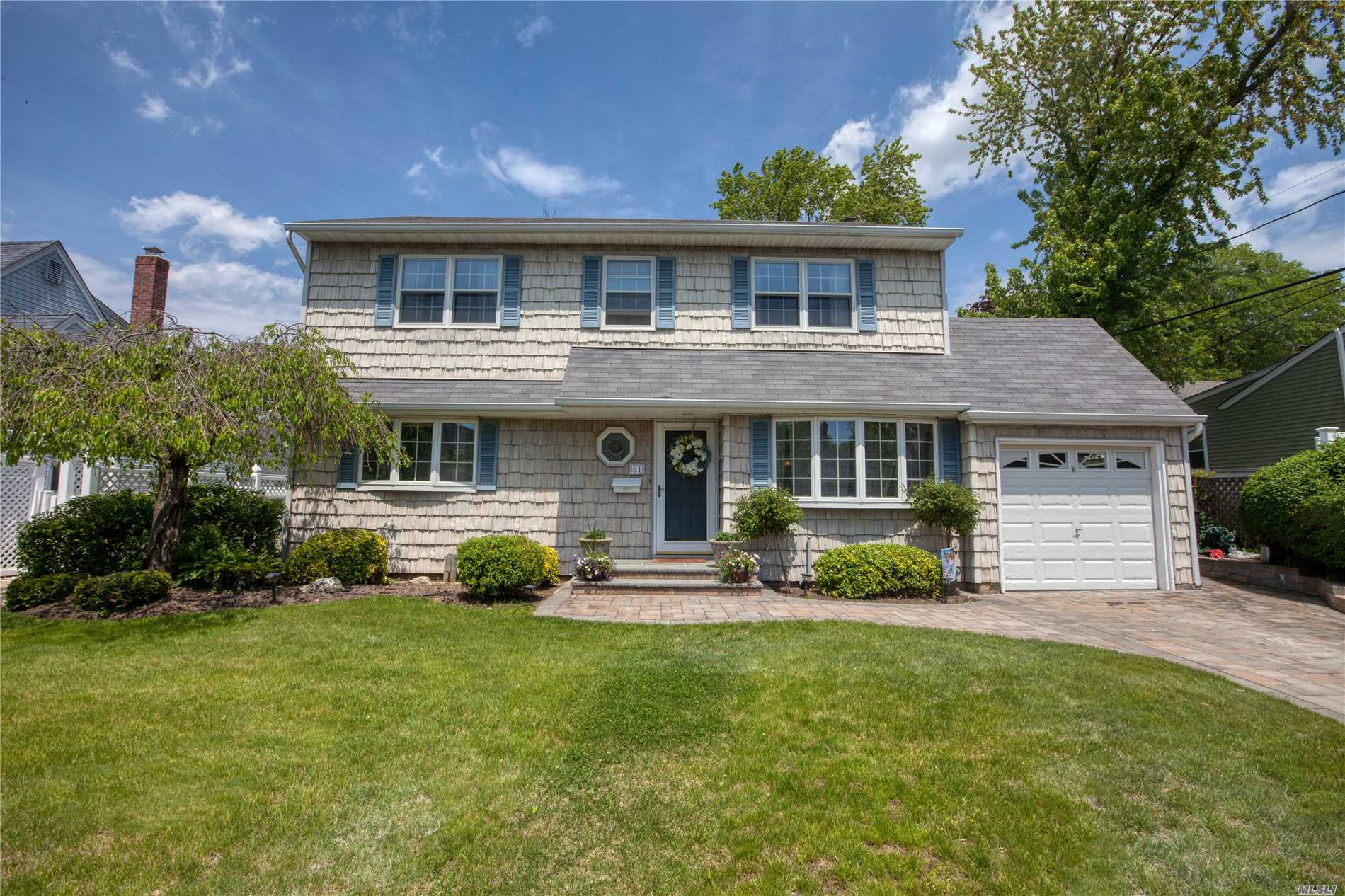 Mint, immaculate large Colonial situated in Lenox Hills, Inc. Village, great curb appeal w/vinyl sided ext., open floor plan, 5 BRS, 2.5 Baths, all large rooms, large updated EIK w/oak cabinets, Main Level Family Rm or 5th BR w/built-ins, large MBR Suite w/2 WIC'S, full, fin Family Rm Basement w/1/2 Bath, h/w flrs, all Andersen windows, newly painted int., 150 amp elec., o/s privately fenced backyard, close to town, shopping & r/r, close to Bethpage State Park & Golf Course. Tax Grievance Filed