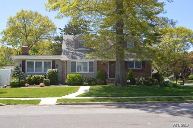 Seaford Manor Expanded Cape, 2 new Baths, New EIK with granite, New carpeting in the basement, New energy efficient boiler. Over sized den with fireplace. Lush landscaping. Fenced in yard. 64x100 property. Seaford schools. ING sprinklers. Gas Heating. Lots of Charm,  Move right in.