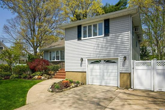 Pride Of Ownership. Split level home situated in the heart of Massapequa Park. Features 3 Bedrooms, 1.5 Baths, Updated Eat In Kitchen, SS Appliances, Granite counter. Other amenities include hardwood floors, gas fireplace, deck and pavers patio. Conveniently Located To Shopping And Transportation. Don't Miss Out, Make This Your Home Today!