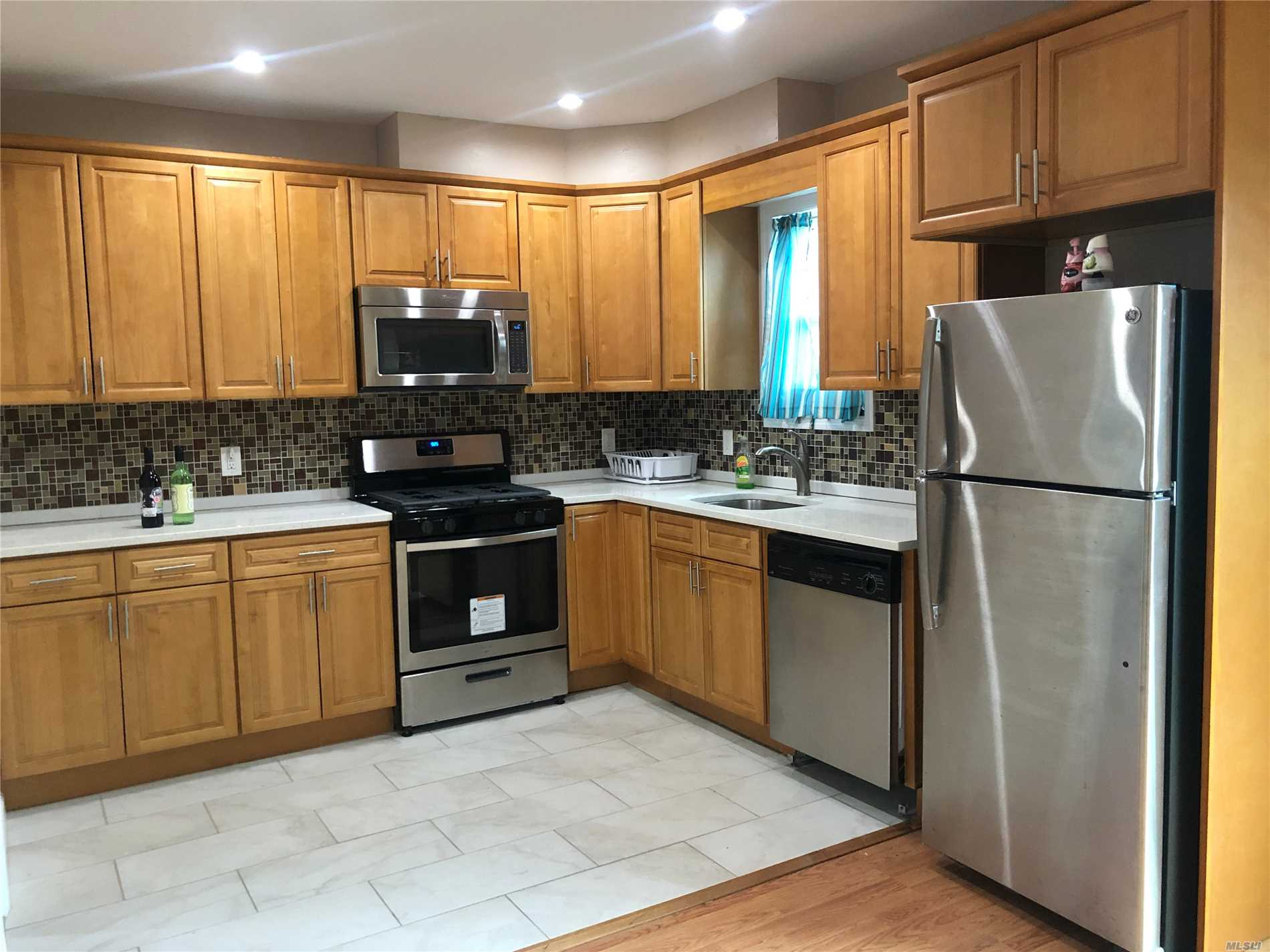 Great, Legal 2 Family features Renovated Kitchen and Baths, Granite and Stainless Steel Appliances. Convenient to Transportation (Buses and M Train), Shopping! 1