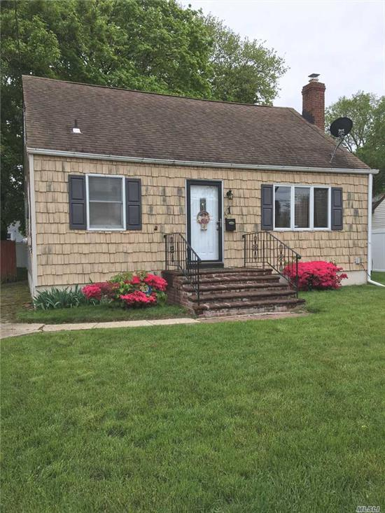 Great Cape For The Money$$$.Nice Size Rooms Hwd Floors Eik + Formal Dining Room Rear Dormer. Large Yard Close To All.