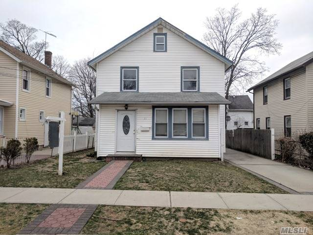 What An Opportunity! This Home Features A Living Room With Fireplace For Entertaining, A Full Basement And 2 Car Garage For Plenty Of Storage, And A Whole Lot Of Charm! Just A Short Distance From All Your Shopping Needs. Don't Miss Out On This One, As It Won't Last! This Could Be Your Dream Home!