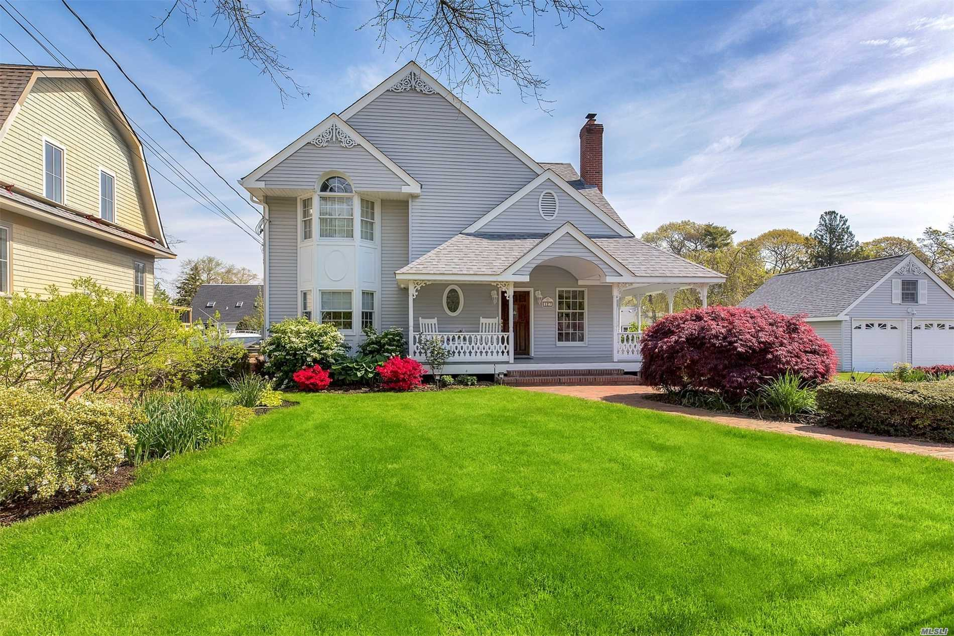 Great Waterfront Location, direct access to Great South Bay, Built in Boat Slip plus Launching area for small watercraft, 175 ' bulkhead, bi level decking IGS, det 2 car garage with huge overhead storage, Beautifully Landscaped with mature plantings, perrenial and rose gardens.