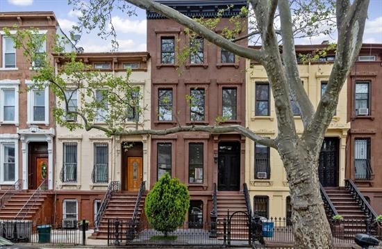 3 Family Brownstone Townhouse in the heart of Bedford Stuyvesant. Fully renovated with over 3300 square feet of livable space. It's truly a masterpiece, designed with modern finishes and enhancing the charm of the old Brownstone. The user unit is a triplex and it has 3 Bedrooms on the ground level with an entrance to the garden, 2.5 Baths, large living room, chef's kitchen with top of the line appliances, laundry & much, much more. The other 2 units are 2 bedrooms, 1 bath, kitchen + LR.