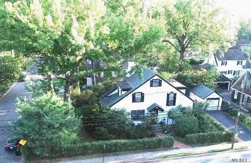 Allenwood Charming Tudor Home; Wonderful Professionally Landscaped Corner Property. Hardwood Floors; Sunny Enclosed Porch off Formal Living Room; Formal Dining Room, Eat-in Kitchen; Priv. Entrance to Room Off Kitchen. Stairs to Attic. Conveniently Located Near All. Enjoy Parkwood Sports Complex w/ Olympic Pools, Lazy River, Ice Skating, Stepping Stone Waterfront Park;Baker Elem School, Grt Neck North Middle/High Schools. Stairs to Attic