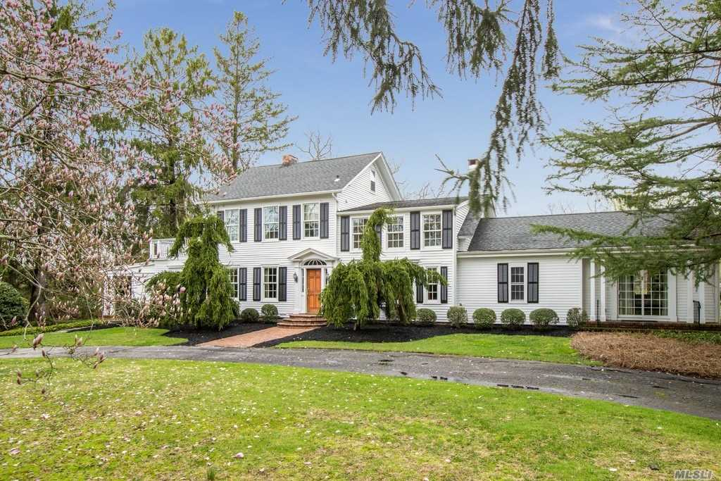 Exquisite waterfront 5 bedroom estate, four car detached garage with 2 bedroom cottage, plus additional beach front cottage set on 4+ prestigious acres on Conscience Bay. Completely renovated with 21st century amenities & Hampton's charm, gas heat, well appointed chef's kitchen, main level master suite, gorgeous wide plank hardwood flooring, sun filled rooms overlooking landscaped property w/mature plantings, 4 fireplaces, & partial basement. Direct waterfrt access for kayaking/boating.