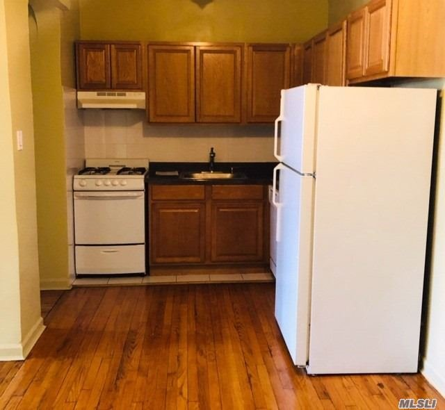 SPACIOUS ONE BEDROOM RENTAL. IN THE HEART OF KEW GARDENS, BEAUTIFUL FOREST PARK CLOSE TO PUBLIC TRANSPORTATION, NICELY RENOVATED.  Huge living room space. Elevator and laundry building. Close to all transportation and shopping.
