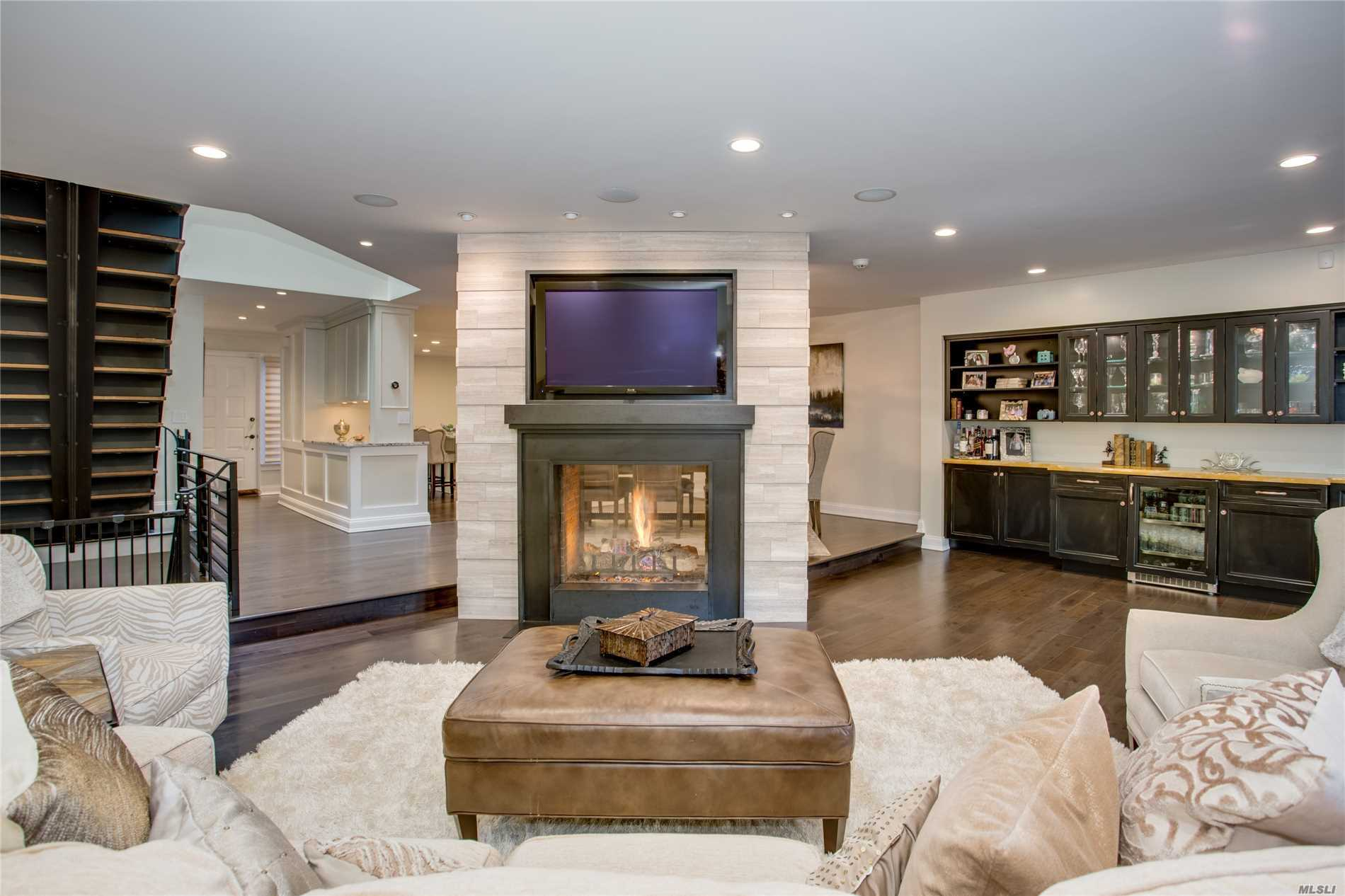 Ultimate Statement of Luxury and fine design rarely found in the Condo marketplace. Elegance Renovated And Redesigned, with the finest designer high end finishes Customized Floor Plan, Dual Fireplaces, Designer Stone throughout Kitchen and Baths, Stainless Steel Appliances, Center Isle, Eat-In-Kitchen, New Modern Steel Railings, Custom Mill Work, Trim, and Moldings Throughout, Walnut Wood Floors. Master Suite Retreat with Dream Closet Finished Basement with wine cellar. RARE FIND