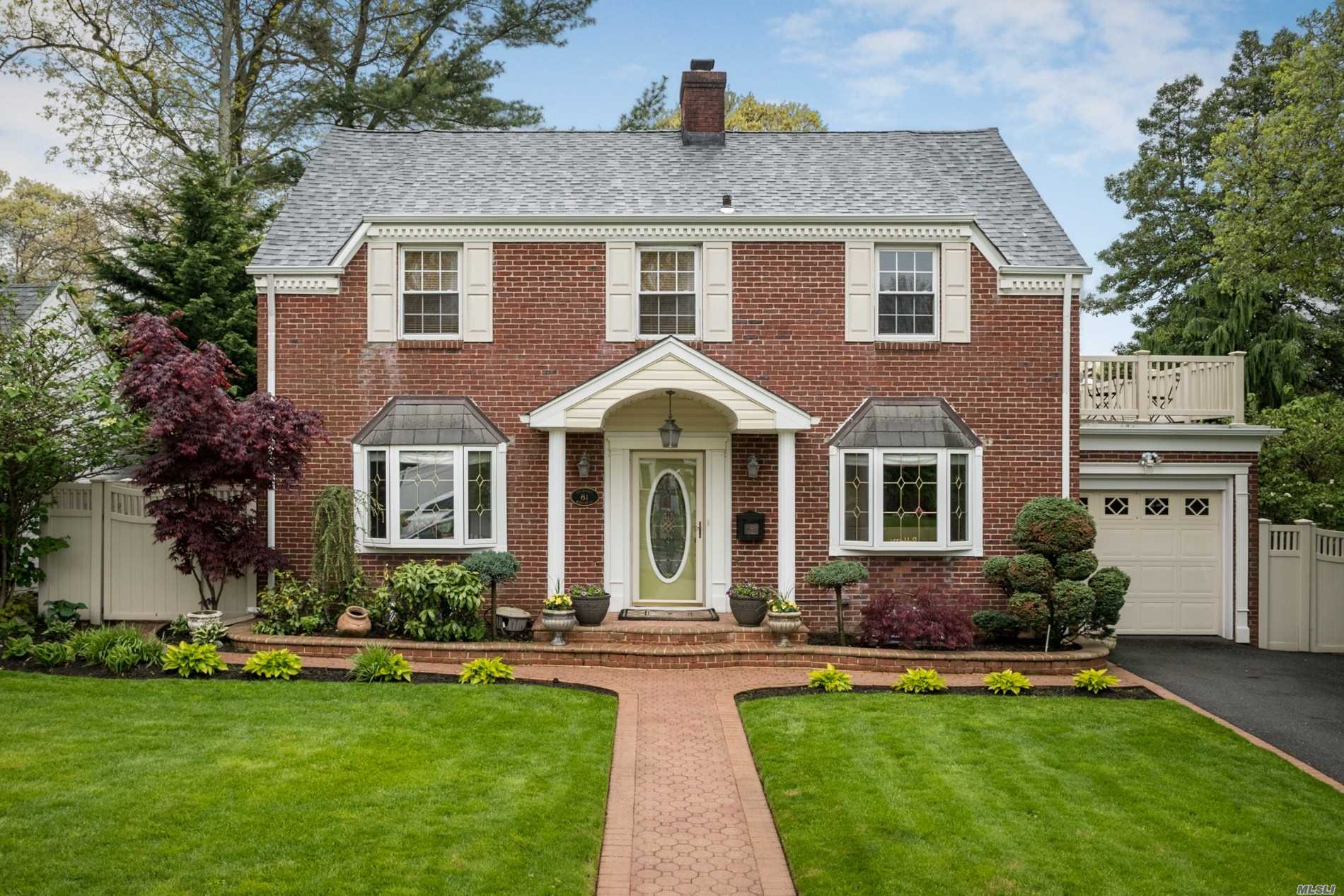 Stunning Stately Exp Center Hall Colonial In N. Freeport w/ Beautiful Curb Appeal. This 2298 Sq Ft Home Has It All! Spacious Extension On Main Flr w/ Open Flow & Tons Of Updates. Gorgeous Stone Fireplace Warms Inviting Living Rm w/ Beautiful French Doors Leading To Cozy Den. Formal Dining Rm Opens To Renovated Kitchen Over Granite Peninsula. Fully Manicured Lawns & Prof Landscaping w/ Full PVC Fence On Over-sized Lot. Entertainers Yard w/ Built-In BBQ & Outdoor Kitchen. Close To Rec Cntr!