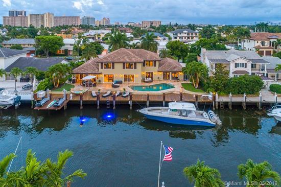 Welcome To The Heart Of Fort Lauderdale--The Yacht Capital Of The World! This Beautifully Renovated Home Offers An Exceptional 115' Of Waterfrontage--Just Seconds To The Intracoastal. Featuring Over 4, 500 Sq Ft Of Living Space, This Gorgeous 5 Bed 5.5 Bath + Media Room Home Offers A 1St Floor Master Suite, Upstairs And Downstairs Laundry Rooms, All Impact Glass, Full House Generator, Top Of The Line Appliances, Outdoor Summer Kitchen, Heated Pool With Spa, Elevator Jetski Lift, Newer A/Cs, Roof And Dock. Don'T Miss This Opportunity To Own A Complete Turn Key Waterfront Mansion In The Beautiful Coral Ridge.