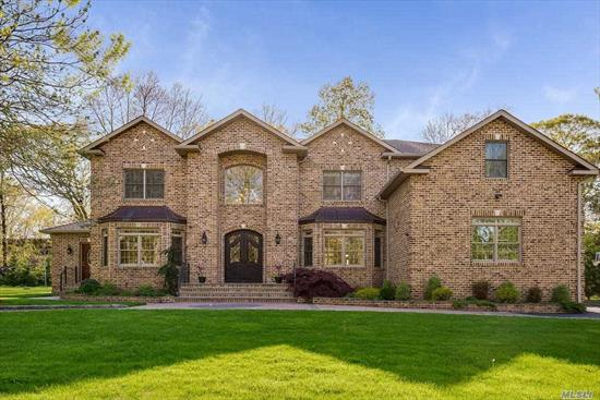 Luxurious estate home built to the highest standards.North Dix Hills stately all brick custom home offers 5000+ sq. feet of elegant appointments-soaring 2 story marble entry, high ceilings throughout including living room w dramtic 20' ceiling, radiant & propane heat & cooking, chef's kitchen w high end appliances + second kitchen, 2 staircases, huge guest ste on main, rich wood floors, palatial bathrooms including ensuite & Jack/Jill.3 car garage.Lush, oversized property.Too much to list! HHH