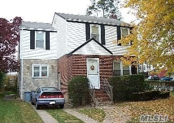 LOW taxes. Argo Colonial. Great location. Easy commute to anyplace. Near where Belt, Southern State & Cross Island meet. Few minutes to LIRR. Extended kitchen with dinette + formal dining room. Good bones. As Is. Needs cosmetic TLC. Bring your creativity and love the potential. Local shopping, bus line, park, many places of worship. Dutch Broadway School area. New HW heater. Shed is gifted. Unfinished basement to renovate and use as you choose.