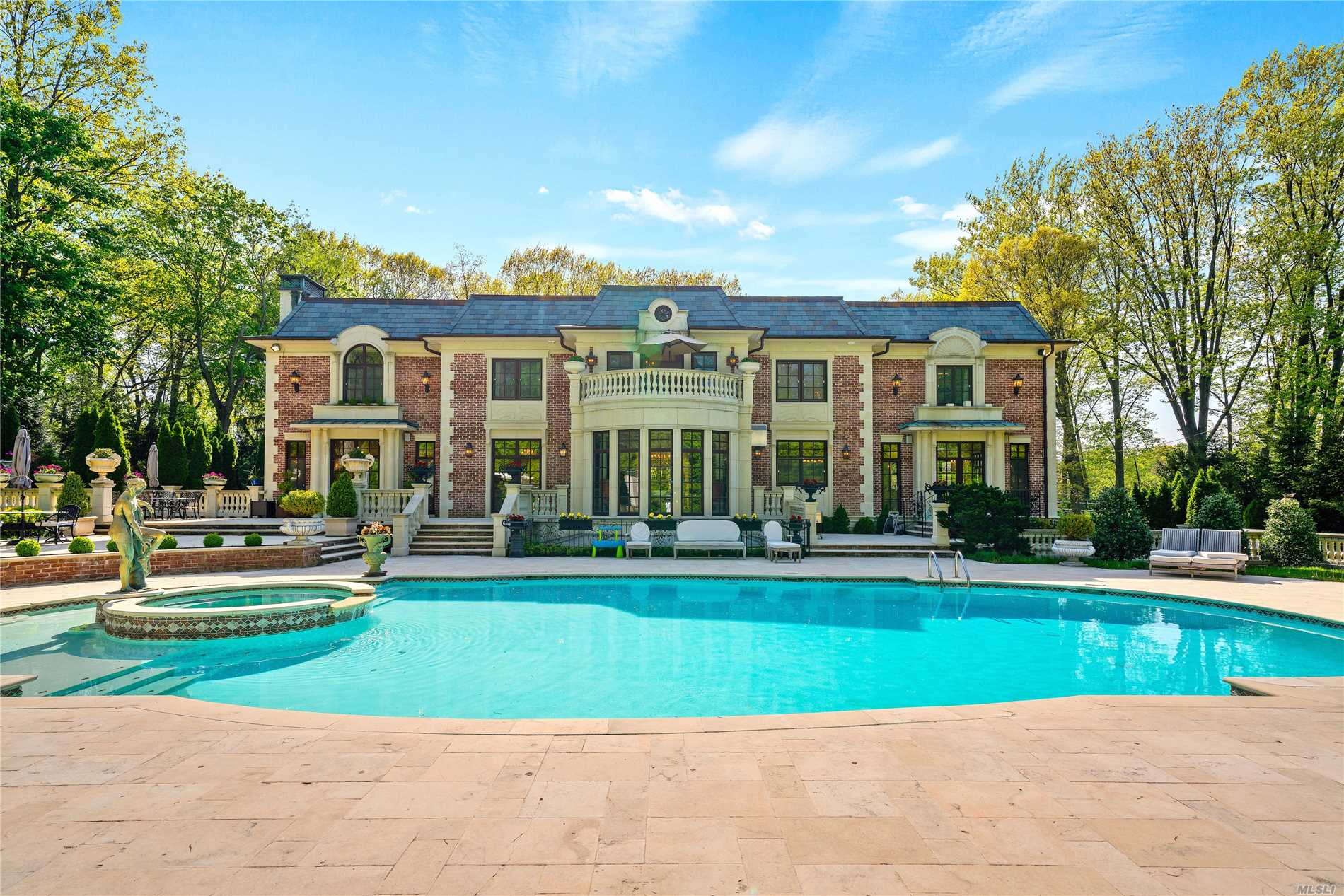 Custom built brick and stone center hall colonial situated an acre of flat property in the prestigious Village of Kings Point. The resort style grounds features a stunning pool with inset hot tub, fountains, oversized stone patio and an expansive outdoor kitchen. The home's interior boasts the highest quality finishes and craftsmanship.