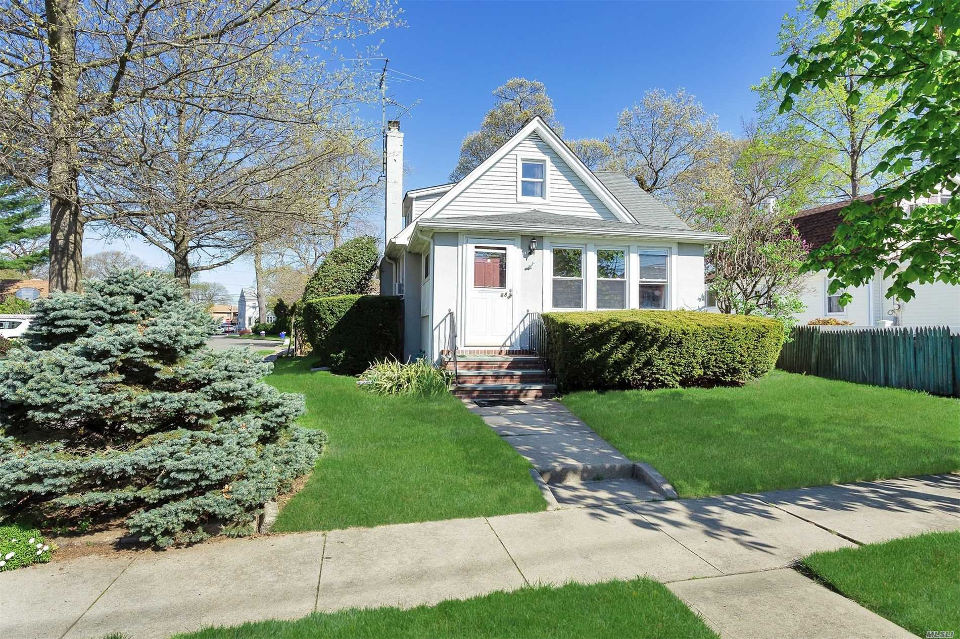 Great Cape Located In The Desirable Westwood Section Of Valley Stream. This home features 4 Bedrooms, 1 Full Bath, Wood Burning Fireplace, Hard Wood Floors Throughout, and Gas Heating and Cooking. Quiet Residential Block. Needs TLC. Being Sold As Is