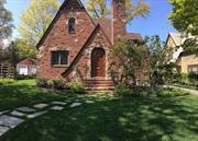 One of a Kind, Open spaced, timeless Tudor In The Prestigious Heart Of Historic Landmarked Douglaston Manor, Vaulted Ceiling, 2 Wood Burning Fireplaces, 2 Car Garage w/Remote, Hardwood Throughout, Large Basement w/Potential Extra Bath. Close To Park & Docks. Residents have easy access to the 636 acre Alley Pond Park, with a range of amenities; the Udalls Cove Park Preserve, an inlet w/marshes & wetlands & the 18-hole public Douglaston Golf Course.