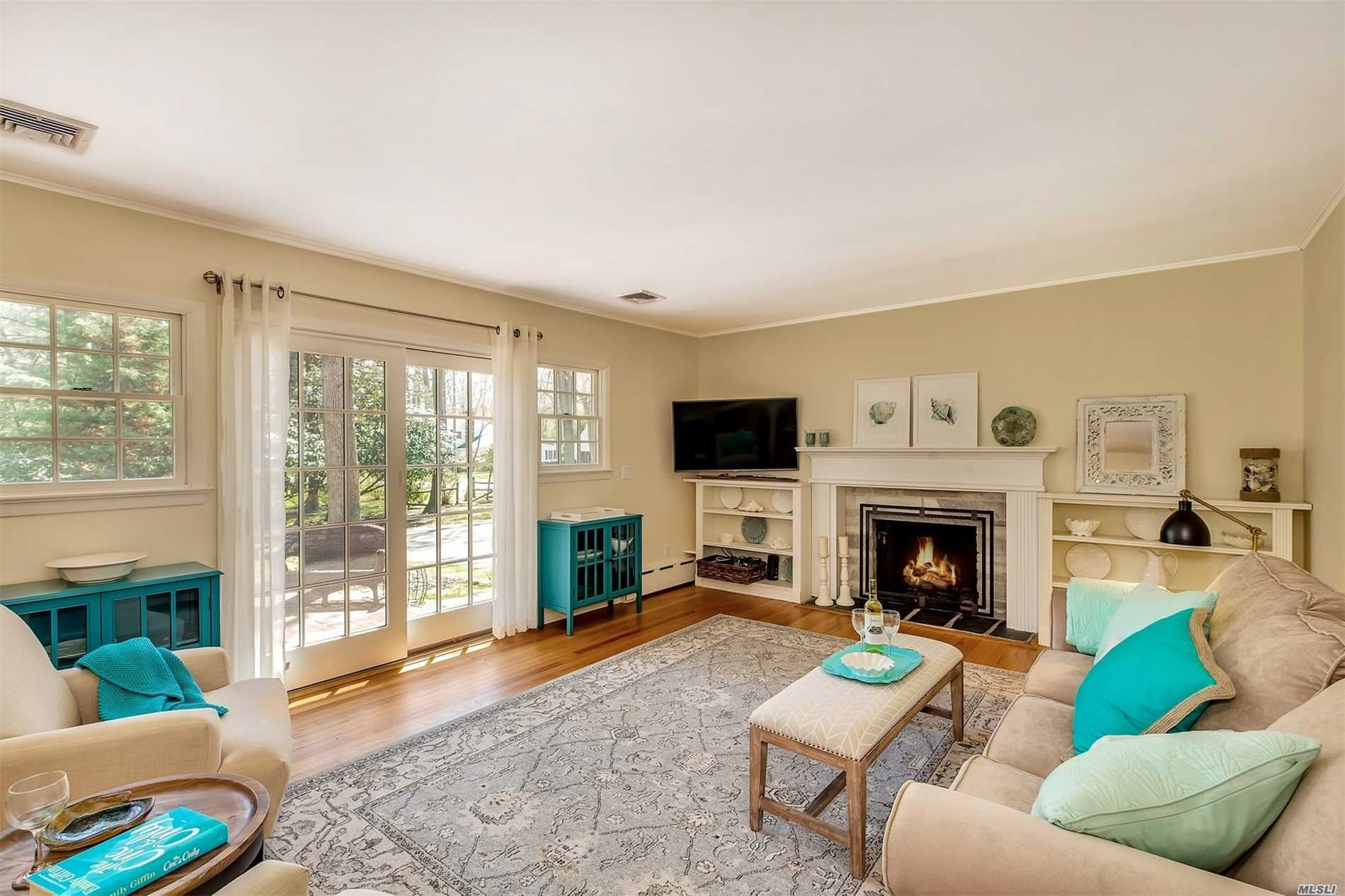 New to the Market! Totally up to date and ready for you to enjoy summer!  Great room with fireplace - combined living room and dining room. Three bedrooms, two new baths, update kitchen, large clean basement for playroom, mancave, gym, etc. Walk to bay boat launch and beach, walk to Southold Yacht Club, walk to Southold hamlet - shopping, public transportation, and dining. Perfect summer getaway or year round living.