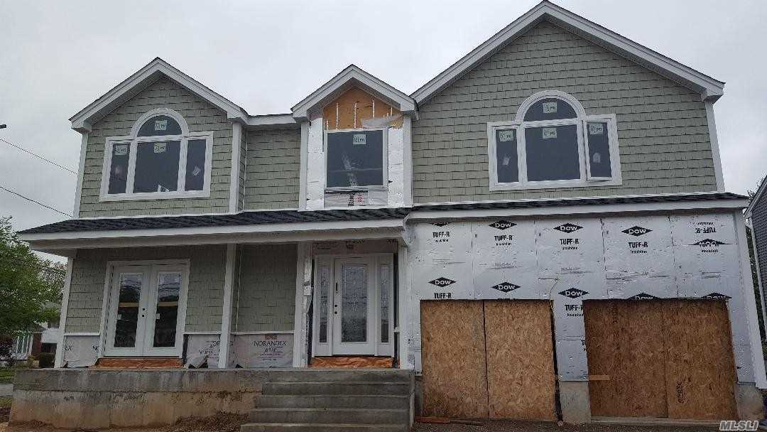 Brand New Construction. Massive 3450 SF Custom 4 Bedroom, 2.5 Bth Colonial On Large Corner Property W Large Yard. Open Floor Plan.Gas Heating And Cooking. Gas Fireplace.Huge Mater Bedroom Suite. Full Lg Unfinished Bsmt W 8 Ft Ceilings And Outside Entrance. Vinyl Siding And Culture Stone. 200 Amp Service. Hi Hats Galore, Crown Molding, Hardwood Flooring. Lg Attic. Front Porch, Oversize Driveway, 2 Car Garage. Still Time To Customize Interior. Fully Fenced