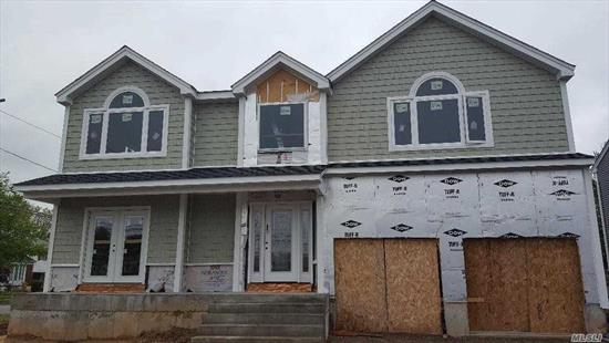 Brand New Construction. Massive 3450 SF Custom 4 Bedroom, 2.5 Bth Colonial On Large Corner Property W Large Yard. Open Floor Plan.Gas Heating And Cooking. Gas Fireplace.Huge Mater Bedroom Suite. Full Lg Unfinished Bsmt W 8 Ft Ceilings And Outside Entrance. Vinyl Siding And Culture Stone. 200 Amp Service. Hi Hats Galore, Crown Molding, Hardwood Flooring. Lg Attic. Front Porch, Oversize Driveway, 2 Car Garage. Still Time To Customize Interior.
