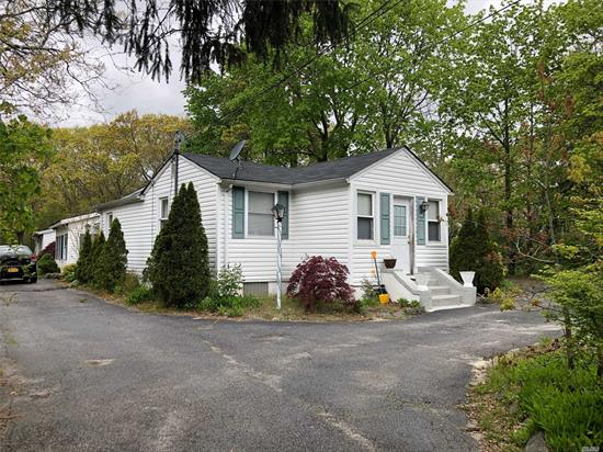 Rare opportunity to own a Legal 2 Family dwelling! 2-ranch style homes located on 2.5 Acre lot. 1st home includes 2-Bedrooms, Full Bth, Updated EIK and Bath, New Roof and basement. 2nd Home includes 3-Bedrooms (used as), Full Bth, Kitchen, LR/Dr and Garage. So many possibilities. Ideal for horse property and plenty of room for expansion, stable, pool etc. Low taxes.