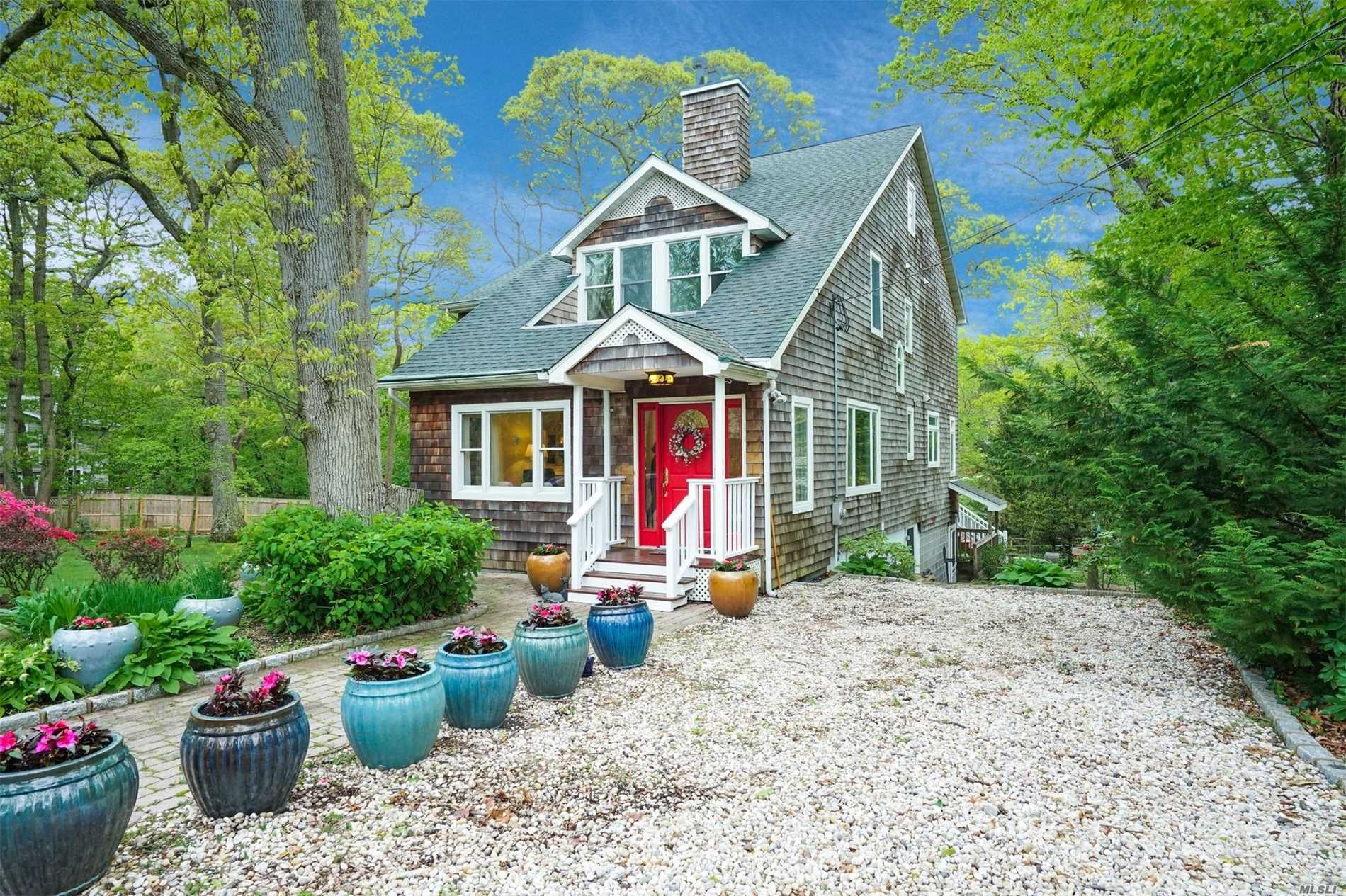 Spectacular StonyBrook Village colonial w/4 bedrms and 3 full bths nestled on a large private wooded lot.The entire home was expanded & renovated in 2000.Open floorplan includes large EIK w/maple cabs&granite which flows to dining area & large den w/fp&large windows overlooking tranquil property.Huge master suite w/skylights , vaulted ceiling , fp, sitting area, spa tub & balcony. Full walkout basement w/fp, french doors, egress windows, rough plumbing for kit & bth and new laundry rm.Simply charming!!