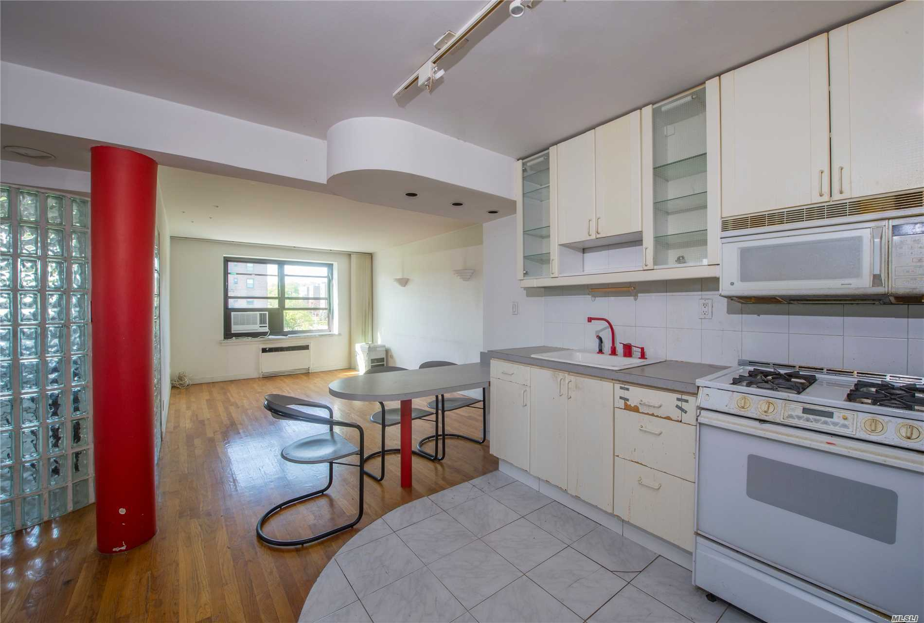 sun filled corner spacious 1 Bedroom & 1 Bath Coop With East Exposures, open Eat-In Kitchen, two New A/C's, Hardwood Floors Throughout, Updated Bathroom, Spacious Bedroom And Affordable Maintenance. Amenities Include Olympic Size Swimming Pool, Tennis Courts, Storage And Parking. Ps 205 Is Blocks Away As Is Jhs  It Has An Onsite Outdoor Pool, Basket Ball Court And Playground. 24 Hour Security, Close To Public Transportation And Shopping. Maintenance Includes Re Taxes, Water & Heat.
