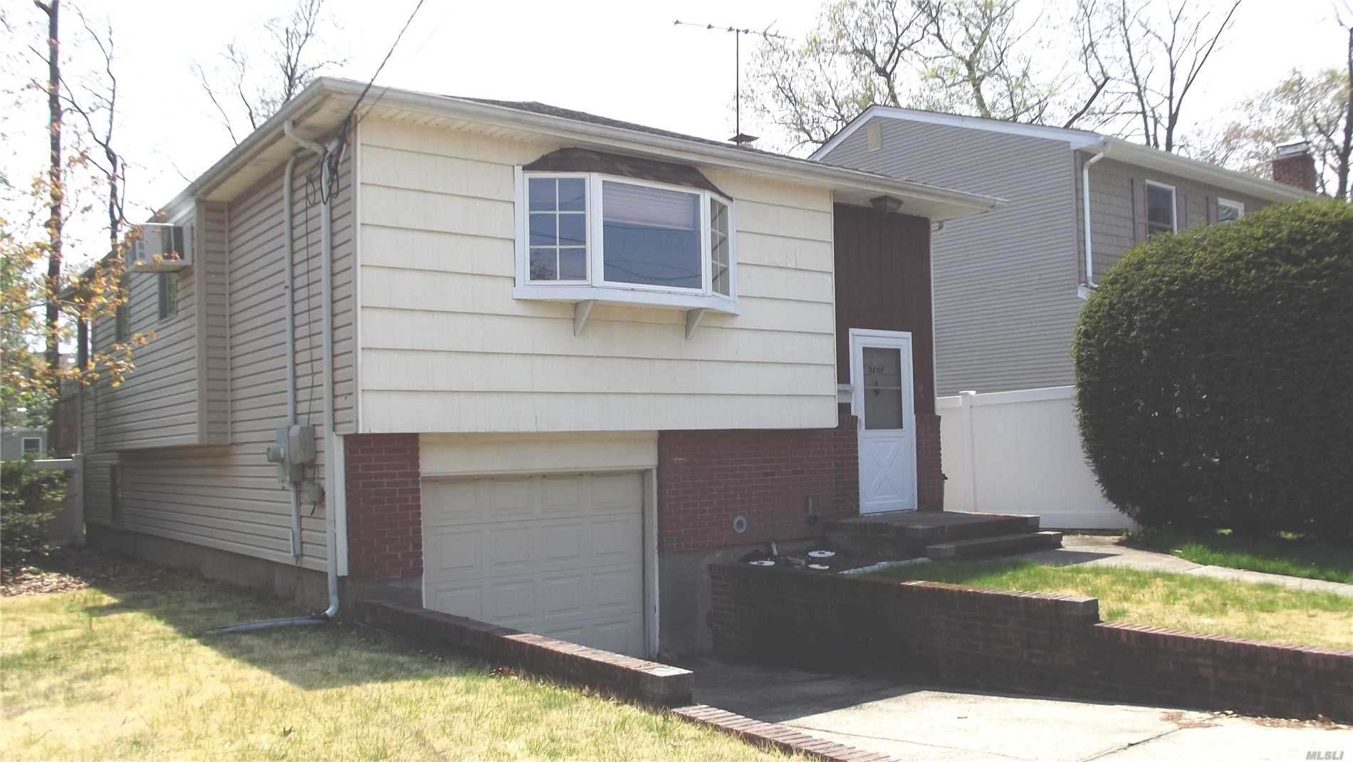 Home on a cul de sac in Seaford Manor! Needs updating- newer roof, heating system and electrical panel. First floor of hi-ranch unfinished / high ceilings/ large windows / separate entrance. Looking for new family to love it!!!