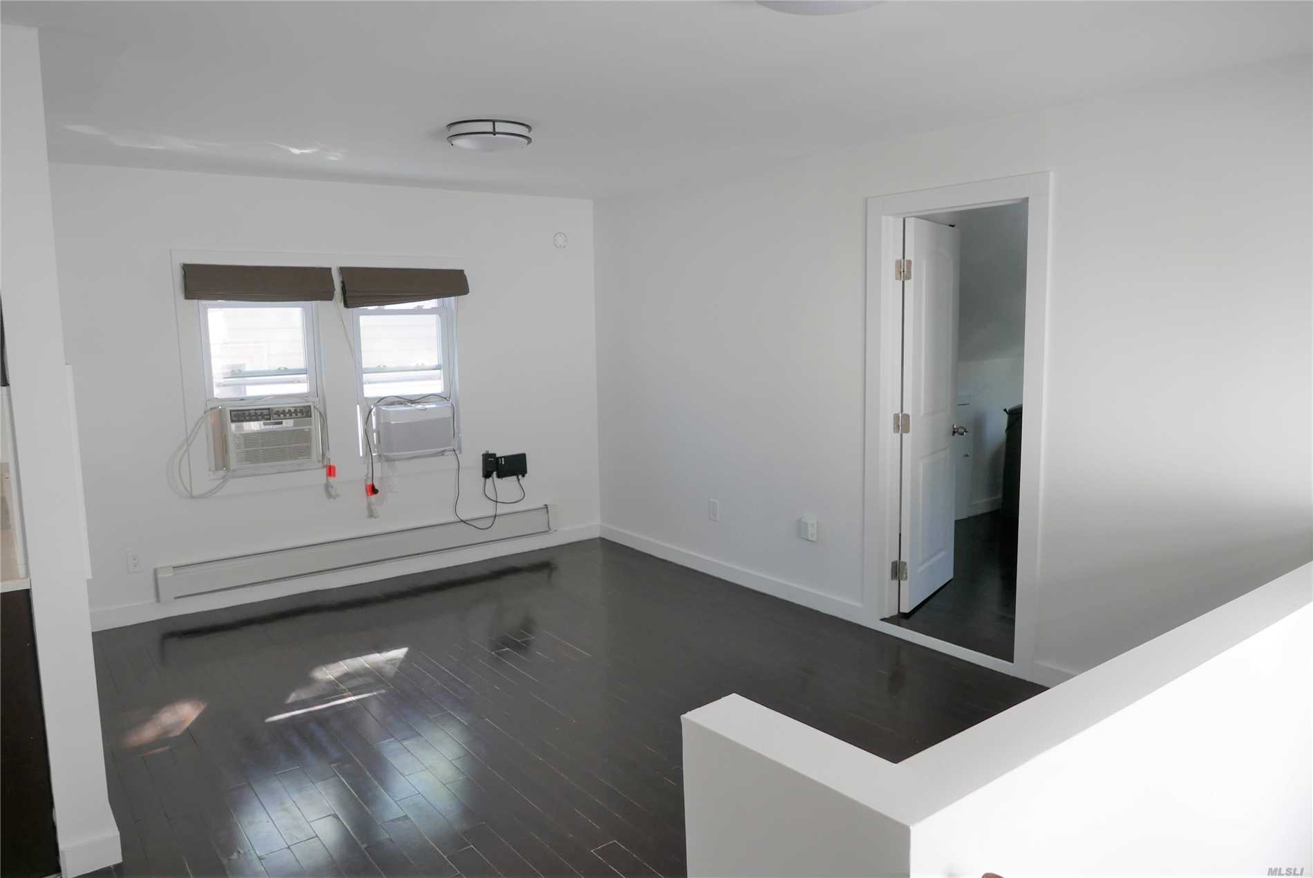 Enjoy this renovated three bedroom apartment. Gourmet kitchen equipped with custom cabinetry, stainless steel appliances. Bright, quiet, hardwood floors and high ceilings. Extra closet space. Custom Cabinets. Walking distance to Key Food. Express bus to Flushing and Forest Hill.