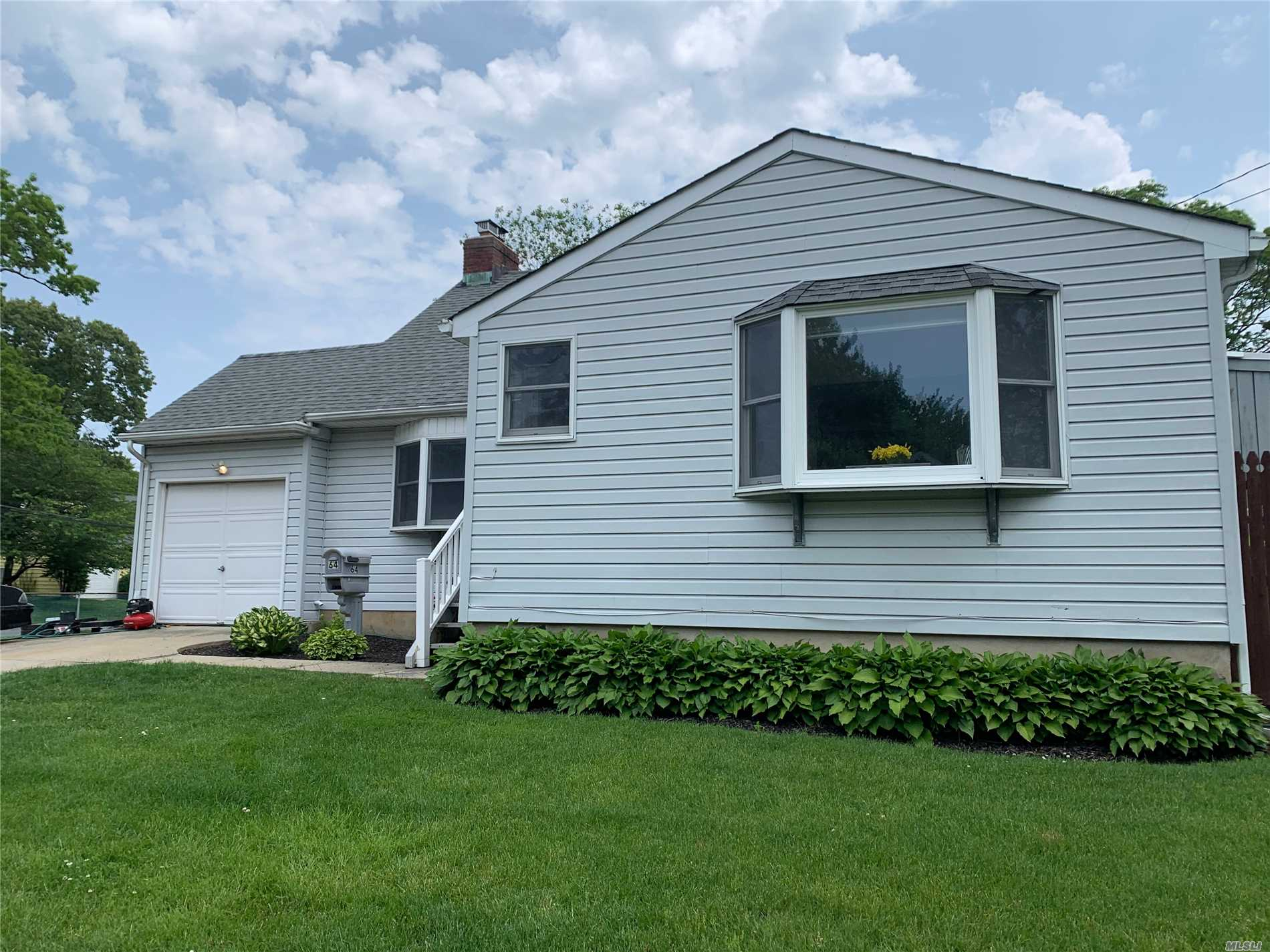 Don't miss this beautiful 4 bedroom, 1 1/2 bath cape with gorgeous renovated kitchen, hardwood floors throughout, CAC, 7 year old roof, 200amp electric, gas heat with 5 zones! Gas fireplace, Tankless hot water heater, washer/dryer on first floor on a corner property in the desirable Southard's Pond area of Babylon!