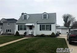 Beautiful Cape in Immaculate Condition Offers Large Livingroom, Large EIK, 4 Bdrms, 2 Full BathsWood Floors thru out, Plenty of closets/Storage, Beautiful yard w/rear Patio, Full Unfinished basement, Parking