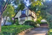This enchanting tudor with storybook charm sits perched on the hills of Manhasset Bay Estates. Great mid-block location. Spacious eat-in kitchen, formal dining space and living room on 1st floor with three bedrooms on 2nd floor. Every room blanketed with sunlight from morning to sundown. Outside, a gardener's dream awaits with a variety of flowers and mature plantings, a front-porch and detached two-car garage. Large attic and full basement. Beach, dock and mooring with required annual fees.