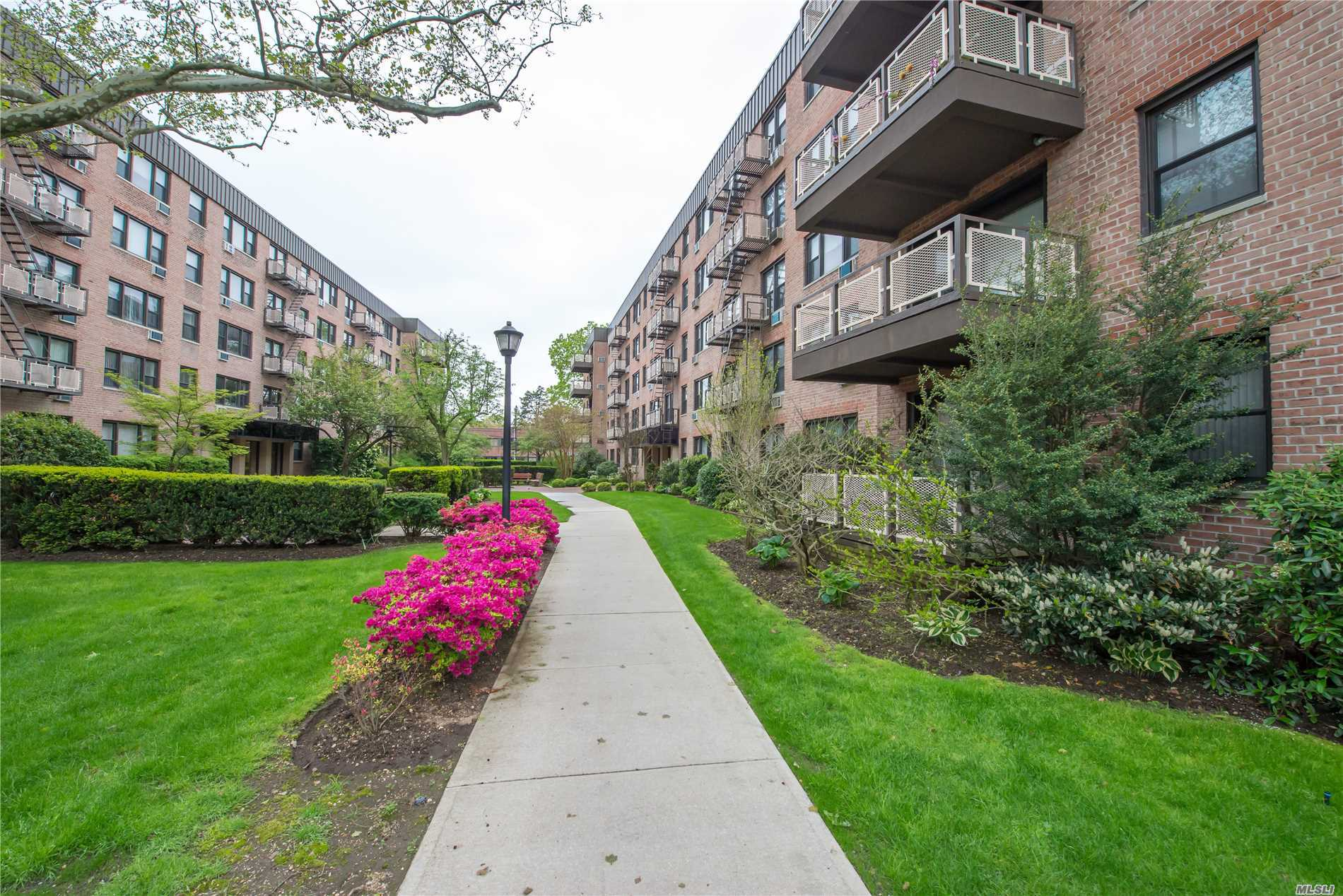 Gorgeous, Updated, 2 Bedroom, 2 Bath Unit In Prestigious Birchwood Court!! This is The Largest Unit-Sutton Model Which Includes A Large Walkout Balcony. This Building Is One Of The Most Desirable In The Development With Easy Access To Old Country Road And Roslyn Road. Amenities Offered Include Laundry Facilities, Storage, Convenience to Railroad, Parkways And Garden City Mall. **This Unit Comes With A Parking Spot**
