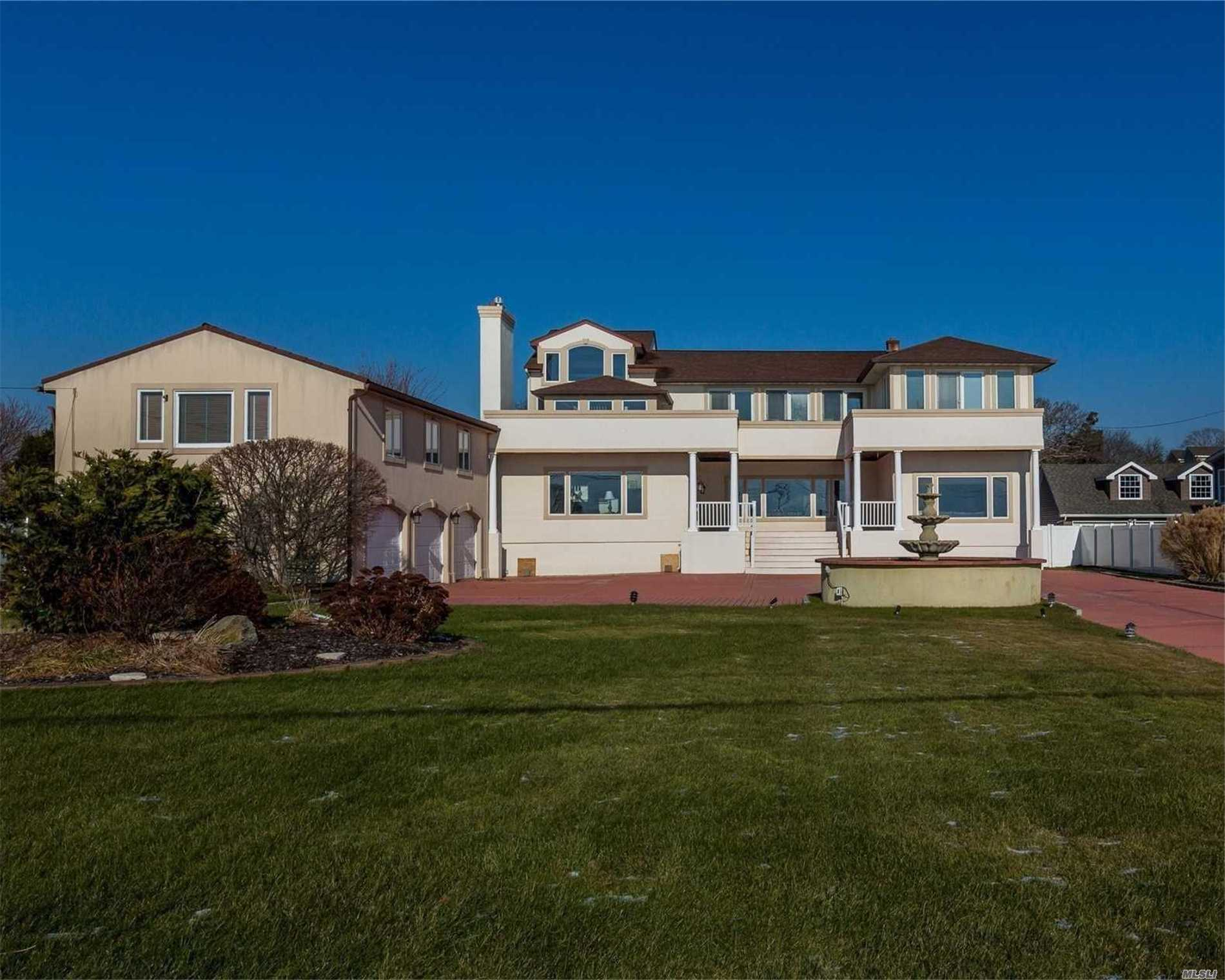 Spacious Tuscan Villa With Spectacular Bay Views! Entire Home Is Raised Per Fema Totally Updated W/ Heated Pool/Patio/Barbeque Area, Large 3 Car Garage W/2nd Floor Heated And Cooled Bonus Area. Location Speaks For Itself!!!