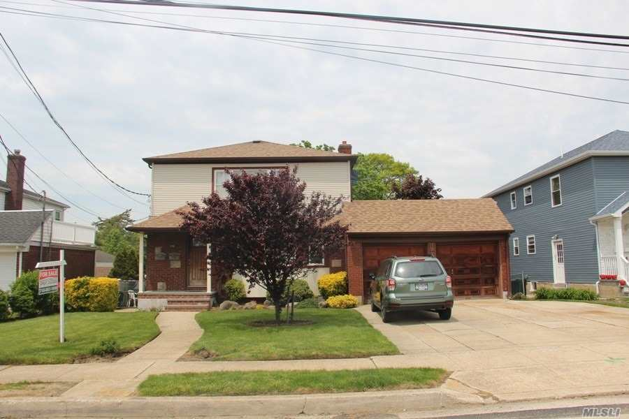 Detached 2 family. 2 car garage. Private driveway. 2/3 brs, 2 full baths. Full basement with 1 br apt, boiler room and laundry room.