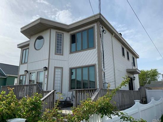 Beautiful Open Floor Plan Located In The Village Of Lindenhurst, Extra Large Rooms, Kitchen Has 2 Jen-Air Ovens, Second Refrigerator Is For Storage. 2 Sets of French Doors Open to the Deck. All New Piping & PVC Electric. Home Owner Ready to Move. Flood Insurance Approx. $750.