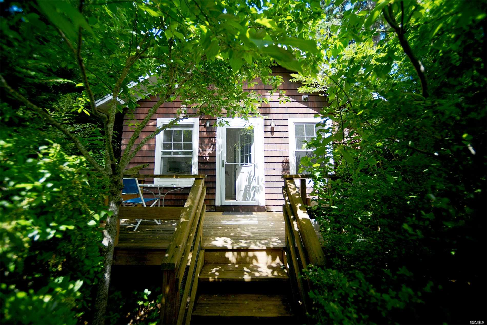 Charming classic vacation cottage - completely renovated and tastefully furnished with eat-in kitchen, bath, living room and 2 bedrooms. A stone's throw from beautiful sandy LI Sound beach. Near vineyards, Love Lane shopping, restaurants, and farm stands. Bike or walk on country roads. Explore the creeks and wetlands of Mattituck Inlet from private dock in your canoe or kayak. $1400 per week with minimum two week stay or $5000 for August 1 - Labor Day.