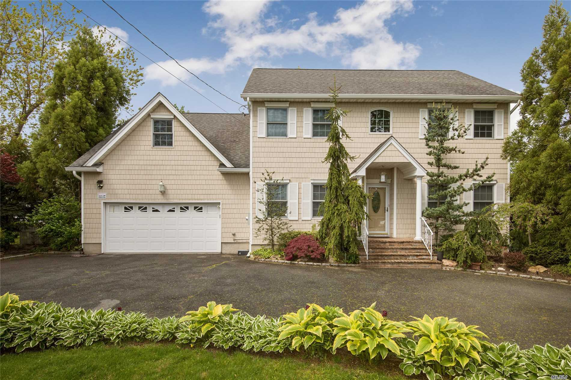 Young Central Hall Colonial in SD 14. Totally renovated, all new top of the line appliances. Circular driveway.