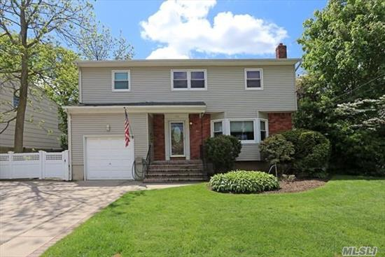 Beautifully Updated Side Hall Colonial Boasts BRAND NEW Kitchen Cabinets, Granite Counters, Stove, Microwave and New Tile Floor w/ Slider to Yard. Dual Level Split Den w/Slider,  King Size Master Suite with Updated Full Bath, 2 Queen size Bedrooms and 4th traditional size bedroom. Hardwood Floors on 2nd level only. Oil tank in bsmt. Too much to list!!!!