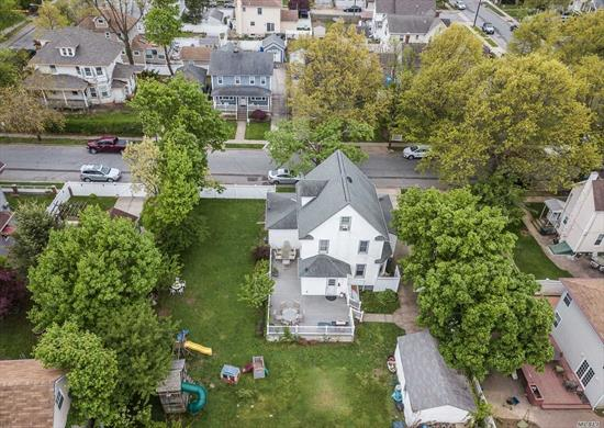 Large, classic colonial with a huge oversized fully fenced backyard, complete with Trexx deck and playground. Just minutes from the Oceanside & East Rockaway LIRR stations, Elementary School #2, and all the shopping & dining both Oceanside and RVC have to offer! Featuring a large finished attic usable as a 4th bedroom with eavespace for added storage; gleaming hardwood floors; enclosed, sun-drenched porch; stately living and dining rooms; and plenty of storage room and potential in the basement!