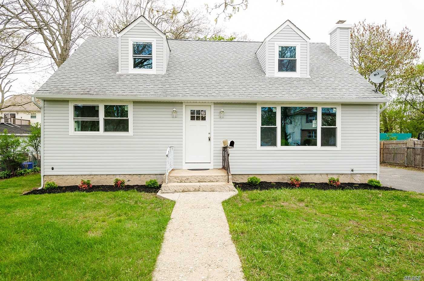 Completely Renovated Turn Key Expansive Cape. New Kitchen with stainless steel appliances and quartz counter top, Modern designed bathroom, new Siding, Flooring, and Windows. Full basement with tremendous storage. Low Taxes!