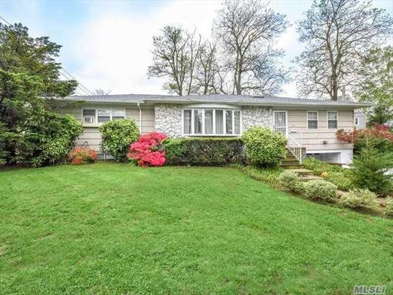 Set on beautifully landscaped property, this sunny and bright Ranch with 3 bedrooms 1 full bath, features spacious living room, formal dining room and large eat-in kitchen. Full basement with laundry. Hardwood floors throughout. Duct Work for Possible AC. New Roof.