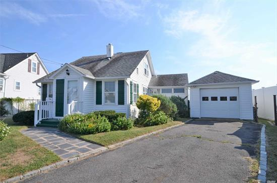 Bayfront Cape 180 Degree Views Of Great South Bay. Breathtaking Sunrise And Sunsets-A Must See Needs a little TLC Priced to sell. Best value in West Islip waterfront community