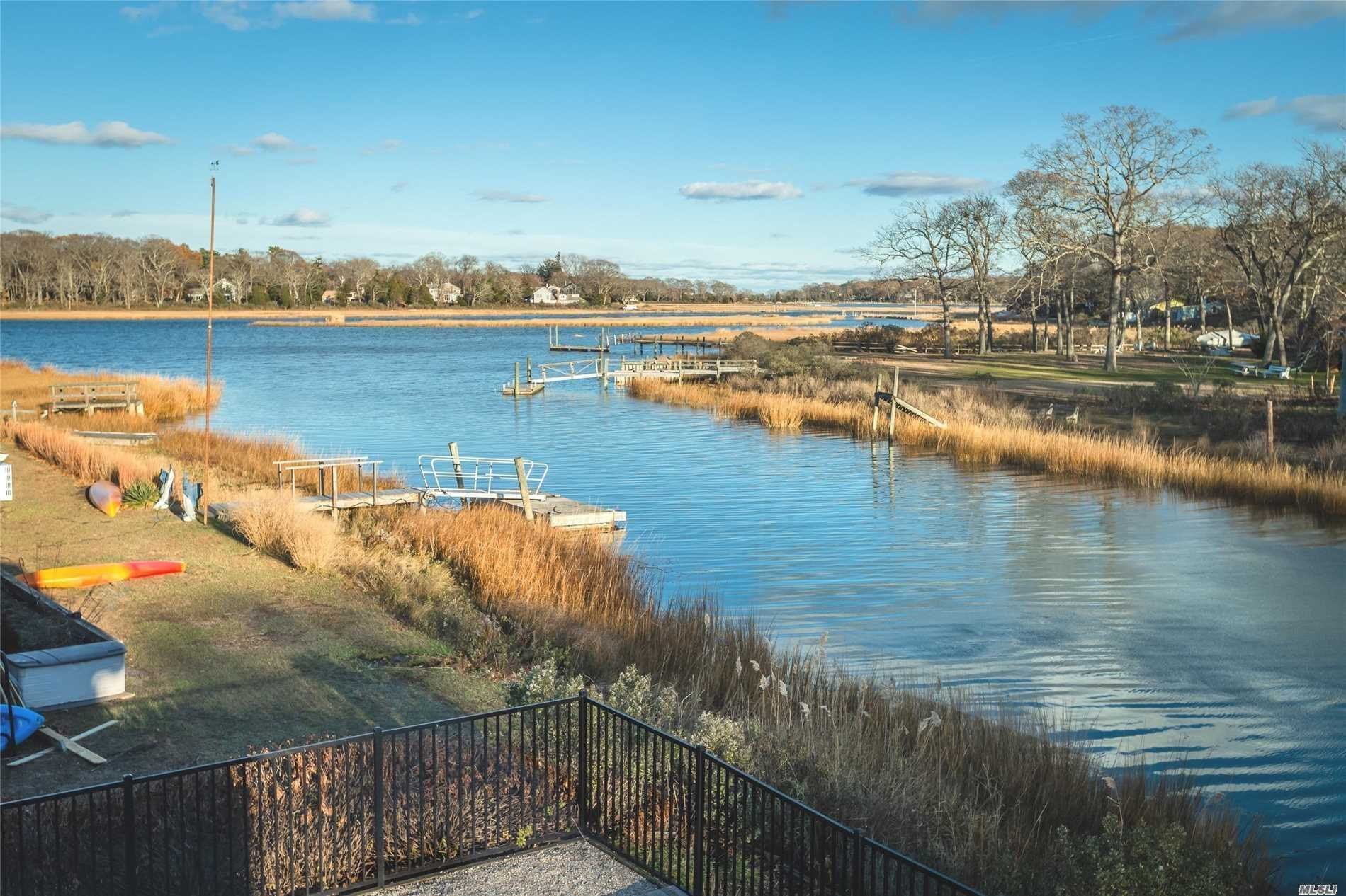 Chic, brand new renovation on stunning estuary with private dock and pool. Sun and dining deck. Beautifully finished interior features Viking appliances, Waterworks fixtures, wood floors, tiled baths. All new HVAC, roof and siding . Attention detail throughout this delightful turn-key how with Fleet's Neck beach rights!!!!!