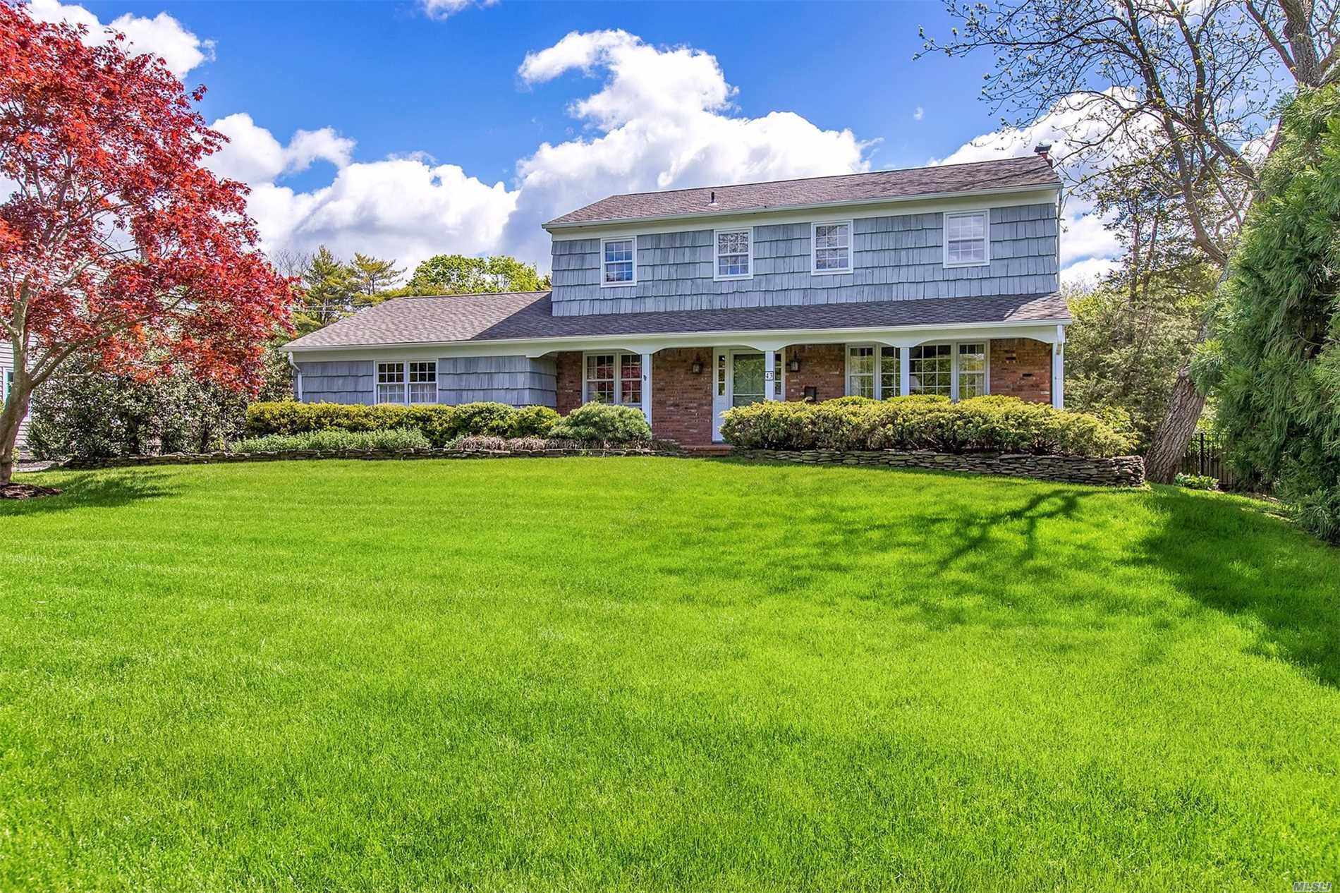 Wonderful classic colonial on maturely landscaped half acre. Long driveway, rocking chair brick front porch, rear screen-enclosed porch and new in ground pool.Inside you'll find beautifully finished hardwood floors and crown moulding throughout, wainscoted ceilings and walls, open concept kitchen and great room with brick hearth and wood burning fireplace. Generously sized bedrooms, master with it's own bath, plenty of closets and full unfinished yet immaculate basement. Just a delightful home!