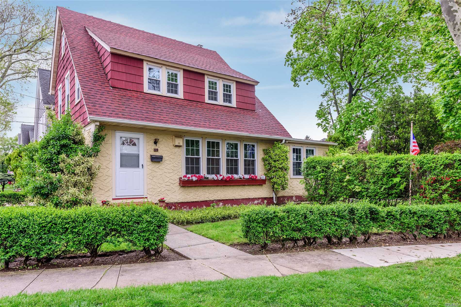 Williston Park. Perfectly located 2 family house on an over-sized lot. Featuring 3 bedrooms, 2 baths, hardwood floors, redone roof & windows, deck, 2 car garage. Won't last!