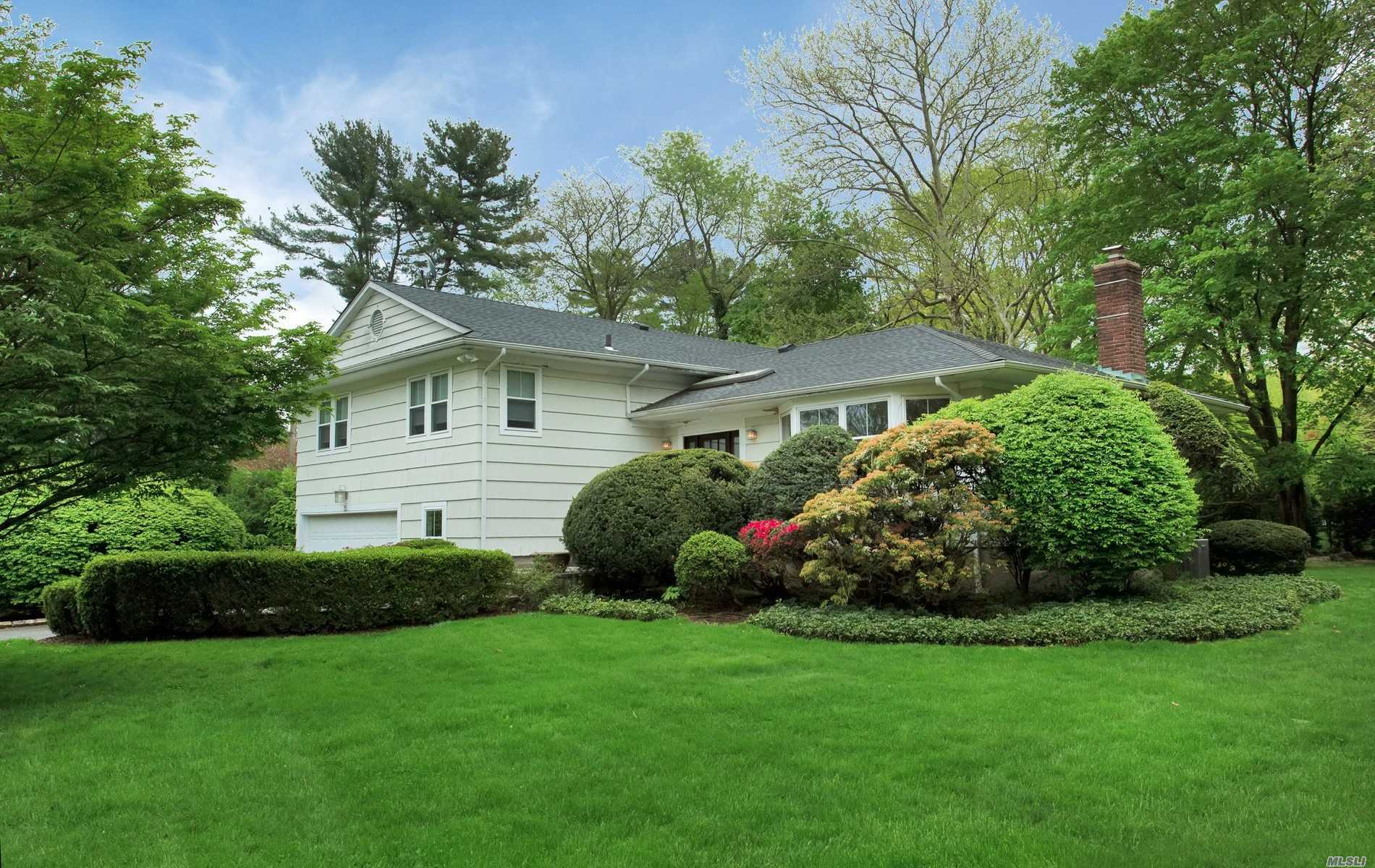 Fabulous location in East Hills. This home offers .42 acres of lush manicured landscaping. 4 bedrooms, 3 bathrooms. Updated EIK with stainless steel appliances. Sun lit living room and dining room. Flat usable property. Fueled by gas. Includes membership to East Hills Park.