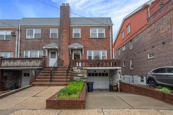 Brick Semi-Detached Colonial In Great Maspeth Plateau Location! House Has Ample Parking With Private Driveway & Garage, Partially Finished Basement With Outside Entrance; Wood Floors, Rear Deck With Great Views Of Manhattan Skyline; Backyard With Lots of Potential.